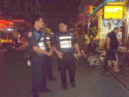 Tourist police volunteers patrol Jomtien Beach bars to give holiday revelers a greater sense of security.
