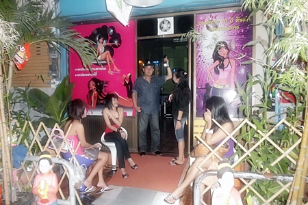 Banglamung Police Superintendent Col. Somnuk Changate (center) leads an inspection of Naklua karaoke bars.