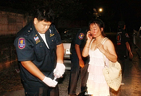 Rescue workers tend to Prinya Harsner before transferring her to the hospital.