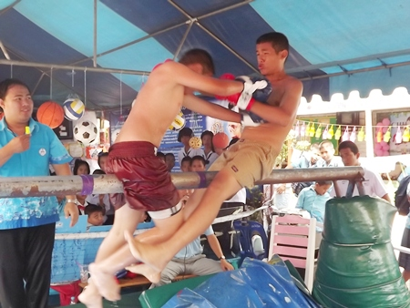 Greased pole Thai boxing is part of the fun at the event.