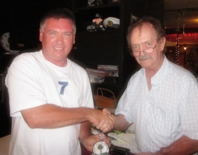 Garry Olliffe (left) receives his Division 1 winner's prize from Stephen Beard.