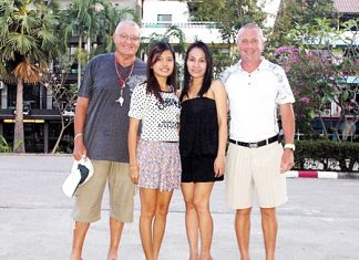 Andy Baber and Terry Redding with two Jomtien golf ladies, Miss Faa and Miss Tar.