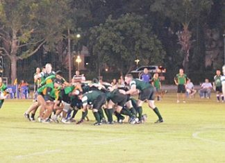 Tong (far left) breaks free from the back of the scrum to attack the U.S. Navy back line.