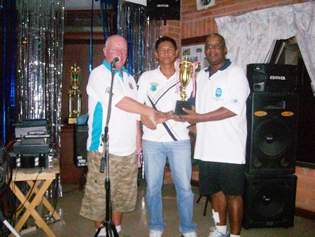 Banksie (center) and Dennis (right) receive the Friday doubles league trophy.