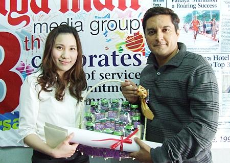 Varongpat Nanthivatcharin, PR coordinator of Nova Group, presents a gift to Kamolthep Malhotra.