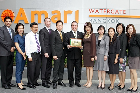 Pierre Andre Pelletier (center), GM of the Amari Watergate Hotel, Bangkok and his management team pose proudly with their 'ASEAN Green Hotel Recognition Award 2012' which the hotel received during the ASEAN Tourism Forum held in Manado, Indonesia recently. The awards are presented to hotels that implement eco-friendly principles in their operations. The award is a sign of appreciation and recognition of tourism stakeholders for adopting the ASEAN Green Hotel Standards into their services.