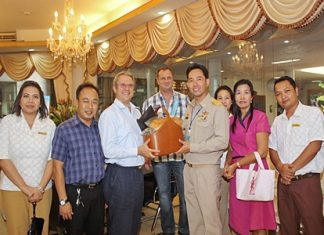 Andre Brulhart (3rd left), GM of Centara Grand Mirage Beach Resort Pattaya together with his management team paid a courtesy call on Pattaya Mayor Itthiphol Kunplome (3rd right) at city hall recently to wish him a Happy and Prosperous New Year. The team included (l-r) Daranat Nuchaikaew, Director of Human Resources, Thanathip Vihokhern, Chief Engineer, Sukanya Wongdornma, Financial Controller and Jeerasak Koisman, front office manager.