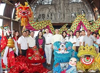 "To celebrate the advent of the Year of the Dragon, the Centara Grand Mirage Beach Resort, Pattaya, led by GM Andre Brulhart (6th left), organized a ""Lucky Lion and Dragon Show"" in the hotel lobby much to the enjoyment of the hotel guests. Management & staff included Natthapaporn Noichan-ad, Thanakrit Saivichit, Thanathip Wihokhern, Daranat Nuchaikaew, Paulo De Matos, Montha Thongngam, Sukanya Wongdornma, Pisutwat Donsuea, Jeerasak Koisman and Narongsak Jitrayon."