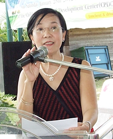 Human Help Network Thailand Director Radchada Chomjinda thanks the people responsible for funding the new homes.
