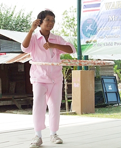 A young dancer demonstrates the new fitness craze - hula hoops.