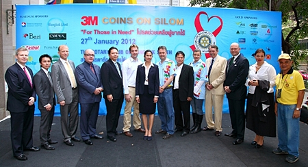 Bangkok Deputy Governor Taya Teepsuwan is flanked by Platinum and Gold sponsors during the opening ceremonies.