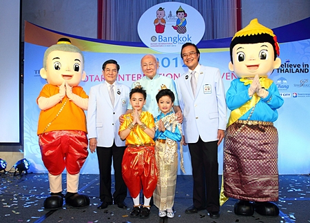 PRIP Bhichai Rattakul together with Past Rotary International Director Noraseth Pathmanand and Akapol Sorasuchart, President of TCEB pose for a photo with convention mascots Nong Yim and Nong Yam - large and small.