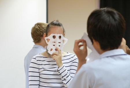 An IB student tries out a mask.