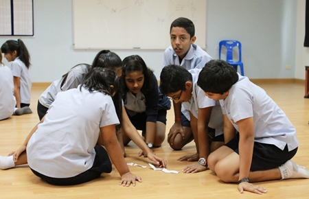 Yr 8 students work on a drama activity.