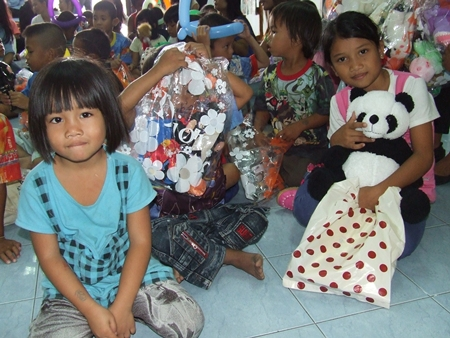 Little ones are happy and thankful for the gifts they are receiving on this special day.