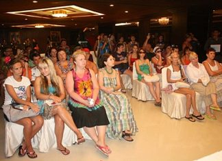 Officials meet with some of the stranded Russian tourists in a town hall style meeting at the Ambassador City Jomtien hotel.