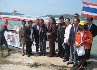 Senate Sport Committee members, led by Sen. Niramol Siriwat, prepare to board a solar powered boat with potential for use in flood crises.
