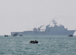Armed forces leave their transport ship and head for Had Yao Beach.