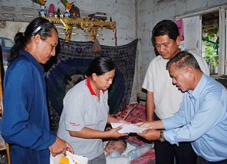 Sattahip officials donated cash, food and diapers for 16-month-old Nathakorn Sae-Chua.