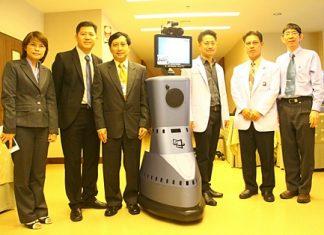 Officials at Bangkok Hospital Pattaya pose with the new Robo Doctor.