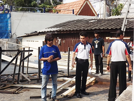 Pongthasith Pijanant, Banglamung assistant district officer, along with officers investigate Tony's Entertainment, the only business that has begun demolition of their buildings over South Pattaya canal.