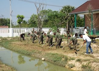 US Marines battle the heat while tilling an area behind the Child Protection and Development Center in Huay Yai to be used as a vegetable garden.