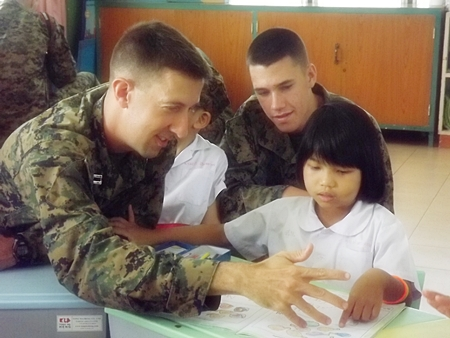 US Marines learn to use sign language with the deaf children.