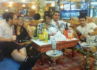 This image taken from a Thai woman's cell phone shows the 3 suspects cavorting with bar girls in South Pattaya.
