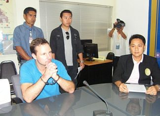 Matthew Dray Plueger (seated, left) is being deported back to the U.S.A. to face drugs charges.