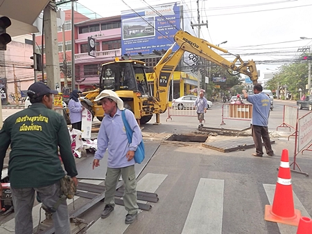 City workers repair damaged drainage pipes and grates at the intersection of Central Road with 3rd Road.