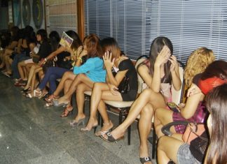 "Police arrested and fined 59 women and transvestites for allegedly ""working"" Beach Road."