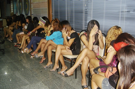 """Police arrested and fined 59 women and transvestites for allegedly """"working"""" Beach Road."""