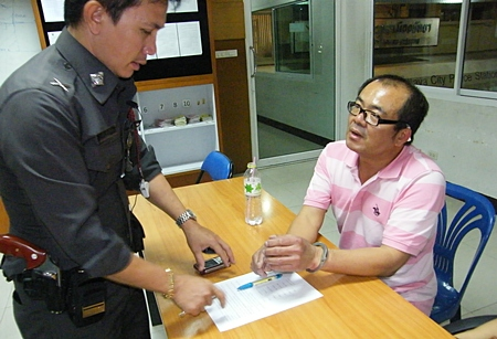 Thanadet Phatthanawaradet (seated) is brought in for shoplifting and possession of illicit drugs.