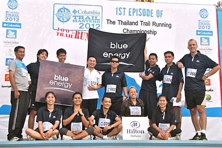"""The team members of Hilton Pattaya led by Harald Feurstein, General Manager (far right, standing row) recently completed the """"Columbia Trail Masters 2012"""", the first Thailand trail running championship at Khao Mai Kheow, Pattaya.  The Hilton Pattaya team also won the 3rd and 2nd runner-up trophies for the marathon discipline.  The winners were Chonticha Satprasit, Assistant Spa Manager (1st from right, sitting row) and Phungporn Wingpad, Kid's Club Attendant (1st from left, sitting row).  Congratulations to the medal winners and all who took part."""