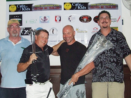 Jon Lay & Kari Kuparinen (center) receive their prizes after finishing first in The Links Challenge charity scramble.