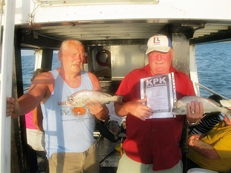 Leif Jansson (right) and Ken Woolley (left) hold up their prize catches.