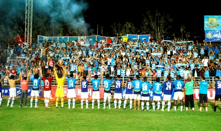 Pattaya United players celebrate with the fans after the 1-0 win over Muangthong United at the Nongprue Stadium in Pattaya, Saturday, Jan. 28.