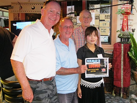 Tuesday's top three with winner Bill Hewitt (center) pose for a photo with a staff member from The Relax Bar.
