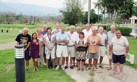 Royal Hills road trip golfers pose with wives and girlfriends for a group photo.