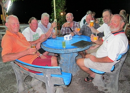"""The anglers enjoy a beer while swapping stories of the ones that """"got away""""."""