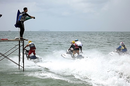 Mayor Ittipol (left) sets the jet-skiers on their way at the start of the weekend water sport festival.
