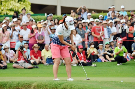 Japan's Ai Miyazato sinks a birdie putt on the final hole.