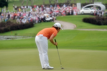 South Korea's Jiyai Shin lines up a par putt on the short 16th hole.