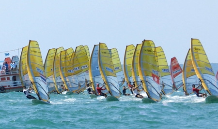 RS-X sailors race off from the start line.