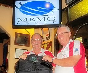 The Scribe (left) receives the MBMG Golfer of The Month award from Dick Warberg.