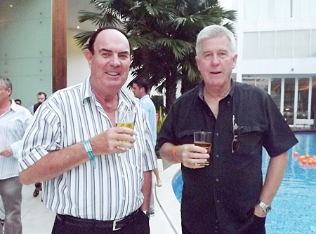 Russell Hancock tips back a beer with Ian Sherratt.