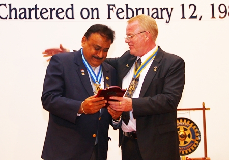 President Gudmund presents an Outstanding      Service Above Self award to PDG Peter Malhotra for 25 years of dedicated service to Rotary, as charter member, President (twice) and District Governor.