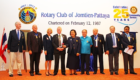 Past and future Presidents of the Rotary Club of Jomtien-Pattaya line up for a photograph. (l-r) Dieter Reigber, Jan Abbink, Judy Hoppe, Gudmund Eiksund, Alvi Sinthuvanik, Premprecha Dibbayawan, Dennis Stark, Max Rommel and Peter Malhotra.