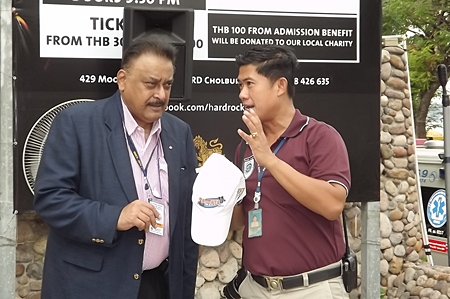 PDG Peter Malhotra and Pol.Lt.Col. Jirawat Sukonthasap, Head of the City Hall Security & Safety Services, discuss the precautionary measures taken to ensure the safety of swimmers and guests both on and off shore.