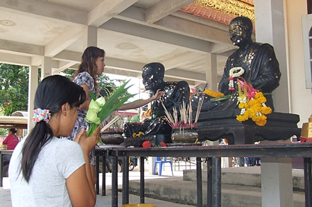 People pay homage to the most revered monks at Wat Nong - Or, Central Pattaya.